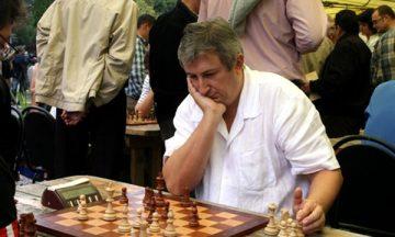 Максим Длуги шахматы